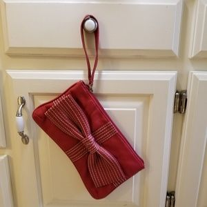 Red bow clutch with wristband.